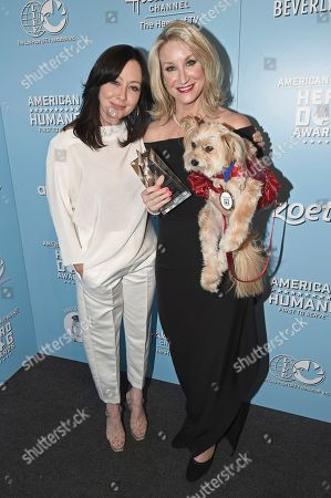 Stock Picture of Shannen Doherty, Lydia Crochet. Shannen Doherty, left, poses with Lydia Crochet and her dog Jeanie, winner of the award for the therapy hero dog of the year, at the 2019 American Humane Hero Dog Awards at The Beverly Hilton, in Beverly Hills, Calif