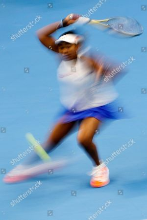 Naomi Osaka of Japan hits a return shot while competing against Ashleigh Barty of Australia in their women's final at the China Open tennis tournament in Beijing