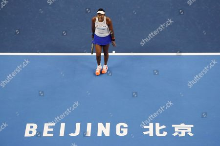 Naomi Osaka of Japan reacts while competing against Ashleigh Barty of Australia in their women's final at the China Open tennis tournament in Beijing