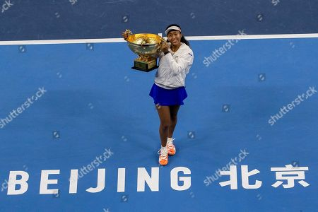 Naomi Osaka of Japan poses with her winner's trophy after defeating Ashleigh Barty of Australia in the women's final at the China Open tennis tournament in Beijing
