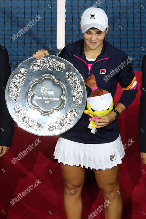 Ashleigh Barty of Australia poses with her trophy after losing to Naomi Osaka of Japan in the women's final at the China Open tennis tournament in Beijing