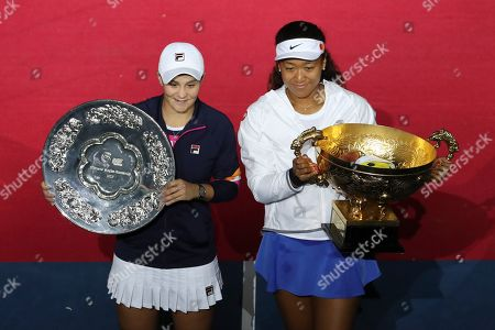 Naomi Osaka, Ashleigh Barty. Naomi Osaka of Japan, left, and Ashleigh Barty of Australia pose with their trophies after the final of the women's singles final at the China Open tennis tournament in Beijing, . Osaka defeated defeating Barty 3-6, 6-3, 6-2