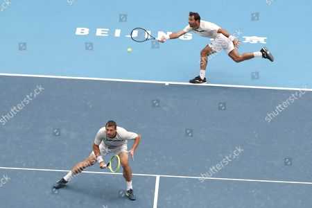 Ivan Dodig, Filip Polasek. Ivan Dodig of Croatia, right, and his partner Filip Polasek of Slovakia play against Lukasz Kubot of Poland and Marcelo Melo of Brazil in the men's doubles final of the China Open tennis tournament in Beijing