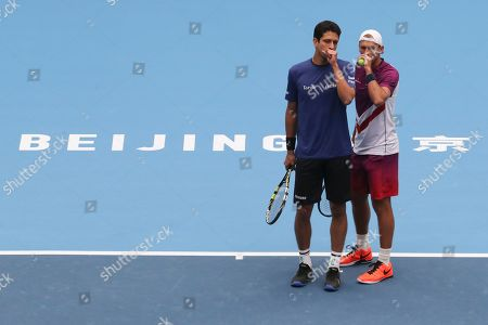 Lukasz Kubot, Marcelo Melo. Lukasz Kubot of Poland, right, chats with his partner Marcelo Melo of Brazil as they competing against Ivan Dodig of Croatia and Filip Polasek of Slovakia in the men's doubles final of the China Open tennis tournament in Beijing