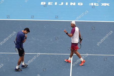 Lukasz Kubot, Marcelo Melo. Lukasz Kubot of Poland, right, and Marcelo Melo of Brazil reacts as they competing against Ivan Dodig of Croatia and Filip Polasek of Slovakia in the men's doubles final at the China Open tennis tournament in Beijing