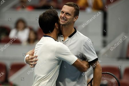 Ivan Dodig, Filip Polasek. Ivan Dodig of Croatia, left, celebrates with his partner Filip Polasek of Slovakia after defeating Lukasz Kubot of Poland and Marcelo Melo of Brazil in the men's doubles final of the China Open tennis tournament in Beijing