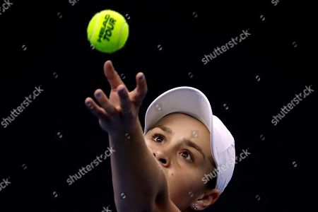 Stock Photo of Ashleigh Barty of Australia serves the ball to Naomi Osaka of Japan in their women's singles championship match at the China Open tennis tournament in Beijing