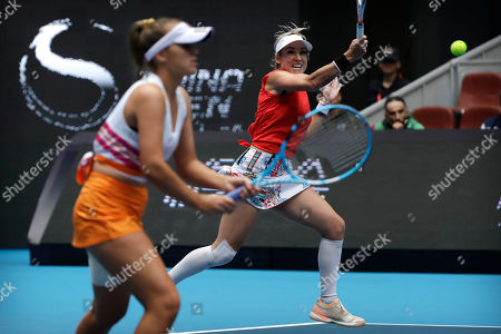 Bethanie Mattek-Sands, Sofia Kenin. Bethanie Mattek-Sands of the United States, right, hits a return shot while competing with partner Sofia Kenin of the United States against Jelena Ostapenko of Latvia and Dayana Yastremska of Ukraine in the women's doubles final at the China Open tennis tournament in Beijing