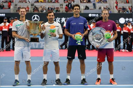 Ivan Dodig, Filip Polasek, Marcelo Melo, Lukasz Kubot. Winner's Ivan Dodig of Croatia, left, and his partner Filip Polasek of Slovakia hold the winner's trophy as Marcelo Melo of Brazil and Lukasz Kubot of Poland pose with their trophy after the award ceremony for the men's doubles final at the China Open tennis tournament in Beijing