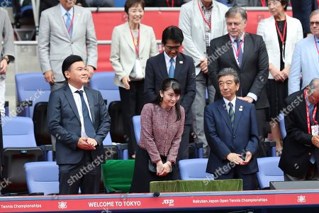 Japan's Princess Mako, center, bows as she arrives at Ariake colosseum for spectates Japan Open tennis championships in Tokyo