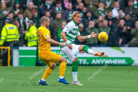 Mortiz Bauer (#13) of Celtic FC plays the ball past Scott Robinson (#17) of Livingston FC during the Ladbrokes Scottish Premiership match between Livingston FC and Celtic FC at The Tony Macaroni Arena, Livingston