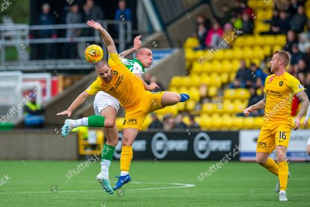 Scott Robinson (#17) of Livingston FC and Scott Brown (#8) of Celtic FC contest a header, as Robbie Crawford (#16) of Livingston FC watches on, during the Ladbrokes Scottish Premiership match between Livingston FC and Celtic FC at The Tony Macaroni Arena, Livingston
