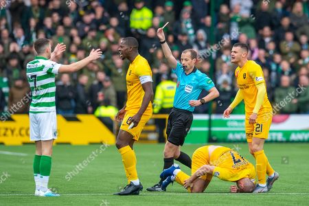 Referee Willie Collum shows Ryan Christie (#17) of Celtic FC a straight red card after his tackle on Scott Robinson (#17) of Livingston FC during the Ladbrokes Scottish Premiership match between Livingston FC and Celtic FC at The Tony Macaroni Arena, Livingston
