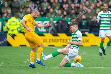 Ryan Christie (#17) of Celtic FC tackles Scott Robinson (#17) of Livingston FC and earns a red card during the Ladbrokes Scottish Premiership match between Livingston FC and Celtic FC at The Tony Macaroni Arena, Livingston