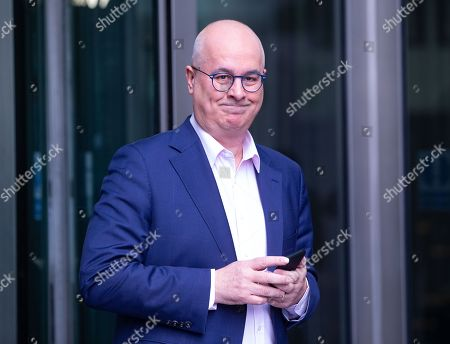 Broadcaster and Journalist Iain Dale leaves the BBC Studios.