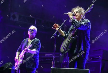 Robert Smith, Reeves Gabrels. The Cure's Robert Smith, right, and Reeves Gabrels perform during the first weekend of the Austin City Limits Music Festival in Zilker Park, in Austin, Texas