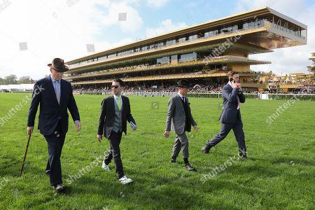 , Paris Longchamp, Trainer John Gosden, Herve Naggar, jockey Frankie Dettori and Thaddeus Gosden (from left) checking the track before the Prix de l'Arc de Triomphe-Day at ParisLongchamp racecourse, France.