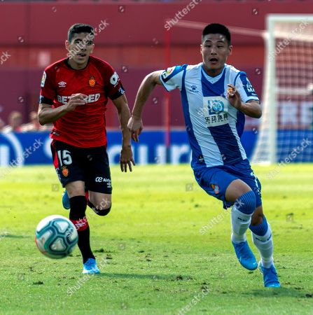 Espanyol's Wu Lei (R) vies for the ball with Mallorca's David Lopez (L) during the Spanish LaLiga soccer match between Mallorca and Espanyol at Son Moix Stadium, in Palma de Mallorca, Balearic Islands, Spain, 06 October 2019.
