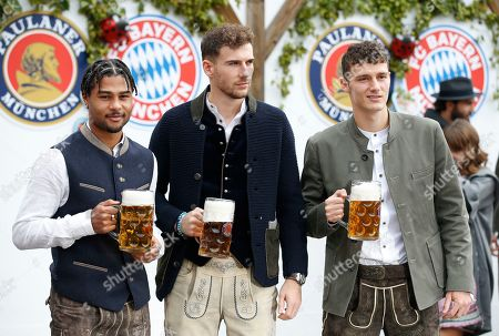 (L-R) Bayern Munich's Serge Gnabry, Leon Goretzka and Benjamin Pavard attend the Oktoberfest beer festival in Munich, Germany, 06 October 2019.