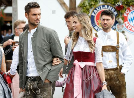 Bayern Munich's goalkeeper Sven Ulreich and his wife Lisa attend the Oktoberfest beer festival in Munich, Germany, 06 October 2019.