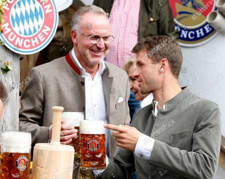 Bayern Munich's CEO Karl-Heinz Rummenigge (L) and player Thomas Mueller attend the Oktoberfest beer festival in Munich, Germany, 06 October 2019.