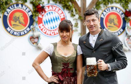 Bayern Munich's Robert Lewandowski  and his wife Anna Lewandowska attend the Oktoberfest beer festival in Munich, Germany, 06 October 2019.