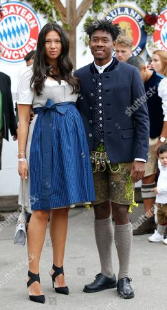 Bayern Munich's David Alaba and his wife Shalimar Heppner attend the Oktoberfest beer festival in Munich, Germany, 06 October 2019.
