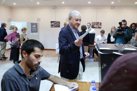 Stock Image of Social Democratic Party (PSD) leader Rui Rio casts his vote in the legislative elections, in Porto, Portugal, 06 October 2019. More than 10.8 million registered voters are called on the day to the polls to elect the 230 deputies for the next legislature and from where the Constitutional Government will take place.
