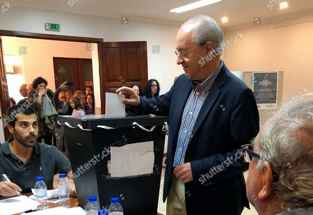 Rui Rio, leader of the Social Democratic Party, casts his ballot at a polling station in Porto . Portugal is holding a general election Sunday in which voters will choose members of the next Portuguese parliament