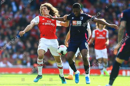 Arsenal's Matteo Guendouzi, left, and Bournemouth's Jefferson Lerma vie for the ball during the English Premier League soccer match between Arsenal and Bournemouth at the Emirates stadium in London
