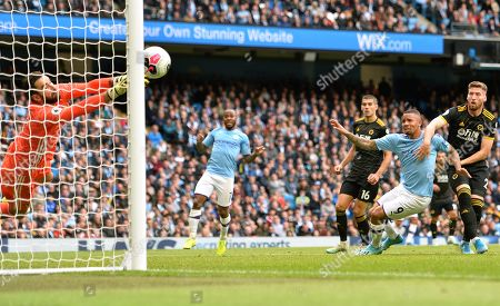 Stock Photo of Wolverhampton goalkeeper Rui Patricio (L) makes a save towards the end of the English Premier League soccer match between Manchester City and Wolverhampton Wanderers at the Etihad Stadium, Manchester, Britain, 06 October 2019.