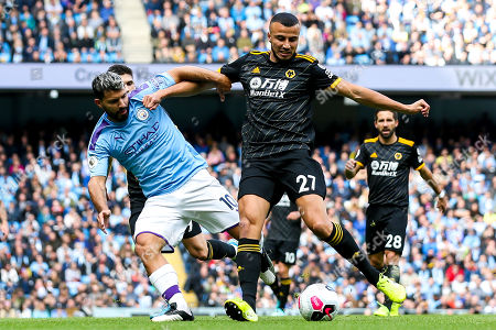 Stock Picture of Sergio Aguero of Manchester City takes on Romain Saiss of Wolverhampton Wanderers
