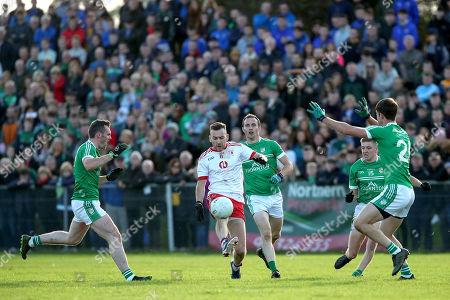 Clann na hEireann,Carragan vs Lamh Dhearg. Lamh Dherag's Kevin Quinn and Gerard McCann with Kevin McShane of Cargin
