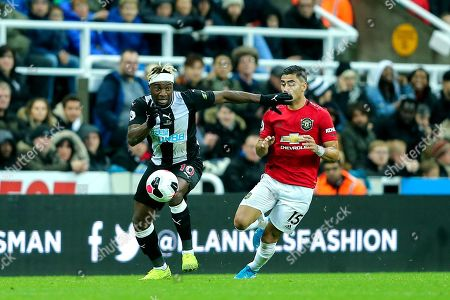 Allan Saint-Maximin (#10) of Newcastle United battles for the ball with Andreas Pereira (#15) of Manchester United during the Premier League match between Newcastle United and Manchester United at St. James's Park, Newcastle