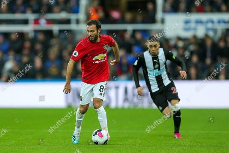 Juan Mata (#8) of Manchester United looks up before playing a pass during the Premier League match between Newcastle United and Manchester United at St. James's Park, Newcastle