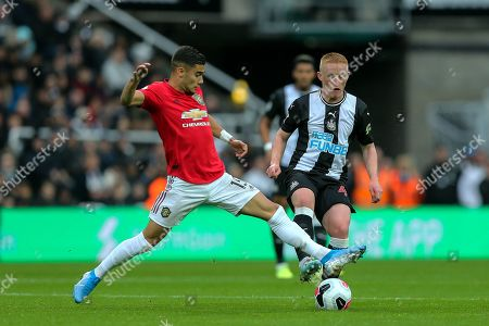 Stock Picture of Matthew Longstaff (#43) of Newcastle United drags the ball away from the challenge of Andreas Pereira (#15) of Manchester United during the Premier League match between Newcastle United and Manchester United at St. James's Park, Newcastle