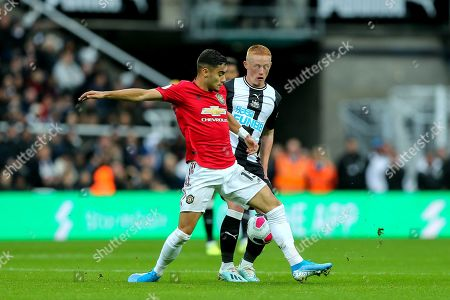 Matthew Longstaff (#43) of Newcastle United drags the ball away from the challenge of Andreas Pereira (#15) of Manchester United during the Premier League match between Newcastle United and Manchester United at St. James's Park, Newcastle