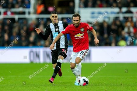 Juan Mata (#8) of Manchester United ont he ball under pressure from Miguel Almiron (#24) of Newcastle United during the Premier League match between Newcastle United and Manchester United at St. James's Park, Newcastle
