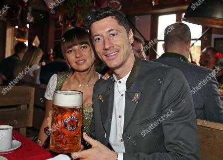 Bayern Munich's Robert Lewandowski (R) and his wife Anna Lewandowska (L) pose as they attend the Oktoberfest beer festival in Munich, Germany, 06 October 2019.