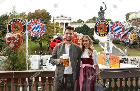 Bayern Munich's goalkeeper Sven Ulreich (L) and his wife Lisa (R) poses as he attends the Oktoberfest beer festival in Munich, Germany, 06 October 2019.