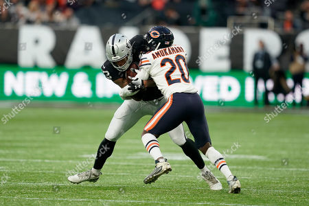Prince Amukamara (DB) of the Chicago Bears tackles DeAndre Washington (RB) of the Oakland Raiders during the International Series match between Oakland Raiders and Chicago Bears at Tottenham Hotspur Stadium, London