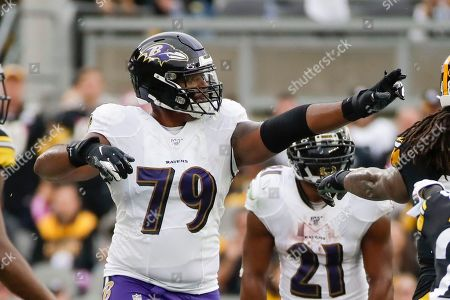 Baltimore Ravens offensive tackle Ronnie Stanley (79) plays against the Pittsburgh Steelers in an NFL football game, in Pittsburgh