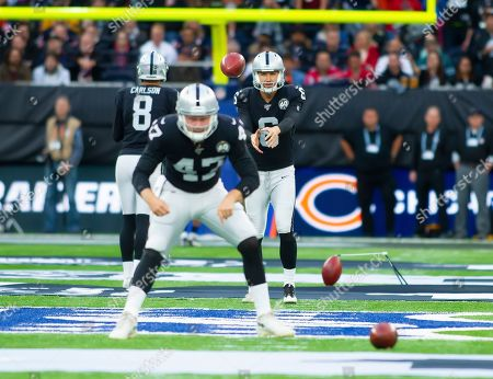 Oakland Raiders Punter A. J. Cole III (6) practices ahead of the game against the Chicago Bears