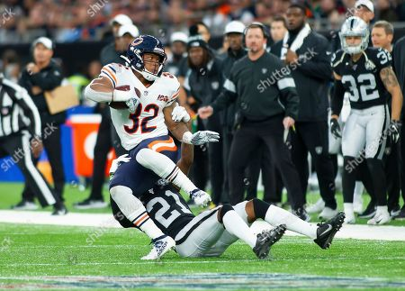 Chicago Bears Running Back David Montgomery (32) is tackled by Oakland Raiders Defensive Back Gareon Conley (21)