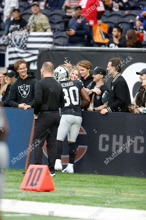 Stock Photo of Jalen Richard (RB) of the Oakland Raiders talking to the fans during the International Series match between Chicago Bears and Oakland Raiders at Tottenham Hotspur Stadium, London