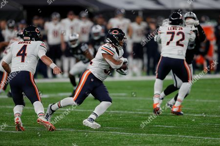 Chase Daniel (QB) of the Chicago Bears hands off ball to David Montgomery (RB) of the Chicago Bears  during the International Series match between Chicago Bears and Oakland Raiders at Tottenham Hotspur Stadium, London