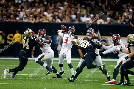 Tampa Bay Buccaneers quarterback Jameis Winston (3) passes under pressure from New Orleans Saints defensive end Cameron Jordan (94) and defensive end Marcus Davenport (92) in the second half of an NFL football game in New Orleans