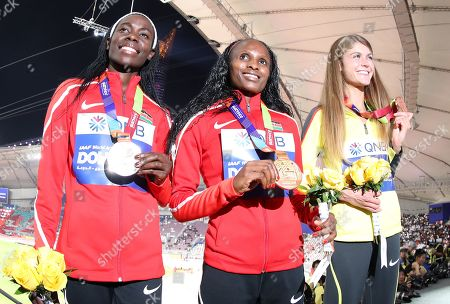 Gold medalist Hellen Obiri (C) of Kenya, silver medalist Margaret Chelimo Kipkemboi (L) of Kenya and bronze medalist Konstanze Klosterhalfen of Germany during the medal ceremony for the women's 5000m at the IAAF World Athletics Championships 2019 at the Khalifa Stadium in Doha, Qatar, 06 October 2019.