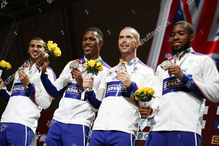 Silver medal winners of Great Britain (from left) Adam Gemili, Zharnel Hughes, Richard Kilty and Nethaneel Mitchell-Blake during the medal ceremony for the men's 4x100m Relay at the IAAF World Athletics Championships 2019 at the Khalifa Stadium in Doha, Qatar, 06 October 2019.