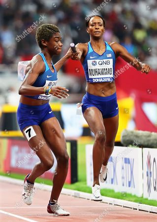 Dalilah Muhammad (R) of the USA hands over to her teammate Wadeline Jonathas (L) on their way to win the women's 4x400m Relay final at the IAAF World Athletics Championships 2019 at the Khalifa Stadium in Doha, Qatar, 06 October 2019.